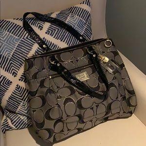 Black and gold Coach purse